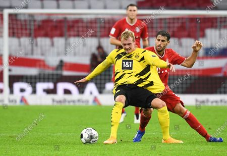 Bayern's Javi Martinez, right, and Dortmund's Julian Brandt challenge for the ball during the German Bundesliga Supercup soccer match between FC Bayern Munich and Borussia Dortmund in Munich, Germany