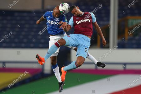 Everton's Fabian Delph, left, jumps for a header with West Ham's Sebastien Haller during the English League Cup round of 16 soccer match between Everton and West Ham at the Goodison Park stadium in Liverpool, England