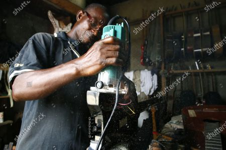 Adicko Pierre, 62, an Ivorian luthier work in his workshop in Abobo, an area of Abidjan, Ivory Coast, 30 September 2020, a day before International Music Day. International Music Day is celebrated every year on October 1. It was established in 1975 by the International Music Council (CIM), itself founded in 1949 by UNESCO. Music plays an essential role for many people and is a powerful vector for intercultural rapprochement. The International Day dedicated to it aims primarily to highlight its importance and that of musicians on a global scale, and to promote the social value that its status as a common language confers on it as a factor of peace and understanding.