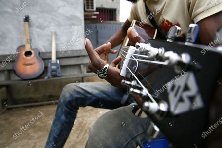 A man plays a guitar in Abobo, a district of Abidjan, Ivory Coast on September 30, 2020, a day before International Music Day. International Music Day is celebrated every year on October 1. It was established in 1975 by the International Music Council (CIM), itself founded in 1949 by UNESCO. Music plays an essential role for many people and is a powerful vector for intercultural rapprochement. The International Day dedicated to it aims primarily to highlight its importance and that of musicians on a global scale, and to promote the social value that its status as a common language confers on it as a factor of peace and understanding.