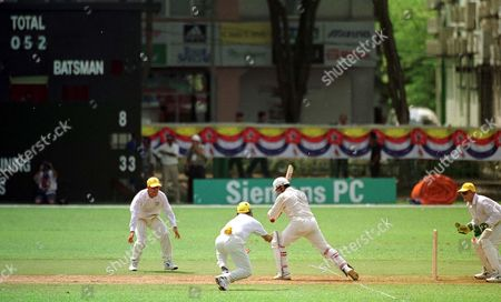 Editorial picture of ***16th Commonwealth Games In Kuala Lumpur 1998***commonwealth Games Kl. Australia Beat Canada At Cricket Wooldridge Special Australias Darren Lehman Dives Forward To Catch Munseb Diwan Canada And Makes Them 52 For 9 In Empty Stadium
