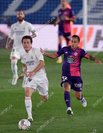 Real Madrid's Alvaro Odriozola, left dribbles past Valladolid's Fabian Orellana, right, during the Spanish La Liga soccer match between Real Madrid and Valladolid at Alfredo di Stefano stadium in Madrid, Spain