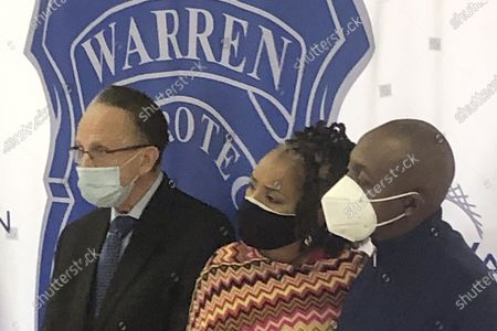Warren, Mich., Mayor James Fouts, left, stands with Candace and Eddie Hall during a news conference, at police headquarters in Warren. A 24-year-old white man has been charged with ethnic intimidation and other counts for firing shots into the Hall's home just north of Detroit after the family put a Black Lives Matter sign in their front window