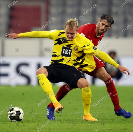 Julian Brandt (L) of Borussia Dortmund in action against Javi Martinez (R) of Bayern Munich during the German DFL Supercup soccer match between Bayern Munich and Borussia Dortmund in Munich, Germany, 30 September 2020.