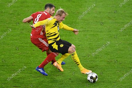 Borussia Dortmund's Julian Brandt (R) in action against Bayern Munich's Javi Martinez (L) during the German DFL Supercup soccer match between Bayern Munich and Borussia Dortmund in Munich, Germany, 30 September 2020.