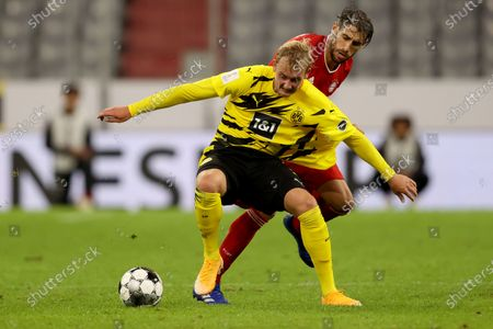Julian Brandt (L) of Dortmund runs with the ball with Javier Martinez of FC Bayern Munchen during the Supercup 2020 match between FC Bayern Munchen and Borussia Dortmund at Allianz Arena in Munich, Germany, 30 September 2020.