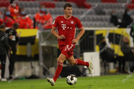 Benjamin Pavard of FC Bayern Munchen runs with the ball during the Supercup 2020 match between FC Bayern Munchen and Borussia Dortmund at Allianz Arena in Munich, Germany, 30 September 2020.
