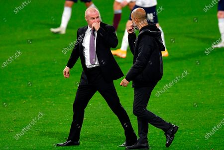Burnley's manager Sean Dyche (L) talks with Manchester City's manager Pep Guardiola (R) at halftime of the English Carabao Cup 4th round soccer match between Burnley FC and Manchester City in Burnley, Britain, 30 September 2020.