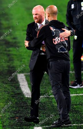 Burnley's manager Sean Dyche (L) and Manchester City's manager Pep Guardiola (R) react after the English Carabao Cup 4th round soccer match between Burnley FC and Manchester City in Burnley, Britain, 30 September 2020.