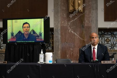 United States Senator Cory Booker (Democrat of New Jersey), right, listens as James Comey, former director of the Federal Bureau of Investigation (FBI) speaks during a hearing in Washington, D.C., U.S.,. The committee is exploring the Federal Bureau of Investigations investigation of the 2016 Trump campaign and Russian election interference.