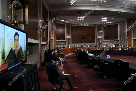 James Comey, former director of the Federal Bureau of Investigation (FBI), left, testifies via videoconference during a Senate Judiciary Committee hearing in Washington, D.C., U.S.,. The committee is exploring the FBI's investigation of the 2016 Trump campaign and Russian election interference.
