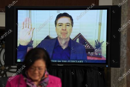 Stock Image of James Comey, former director of the Federal Bureau of Investigation (FBI), swears in via videoconference during a Senate Judiciary Committee hearing in Washington, D.C., U.S.,. The committee is exploring the FBI's investigation of the 2016 Trump campaign and Russian election interference.
