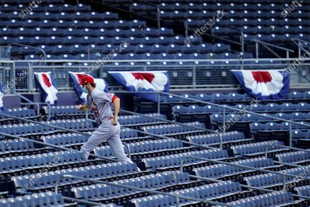 Stock Image of St. Louis Cardinals relief pitcher Andrew Miller climbs the stairs in the stands before Game 1 of the National League wild-card baseball series against the San Diego Padres, in San Diego