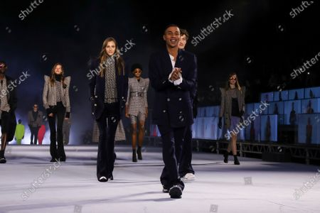 Olivier Rousteing with models on the catwalk