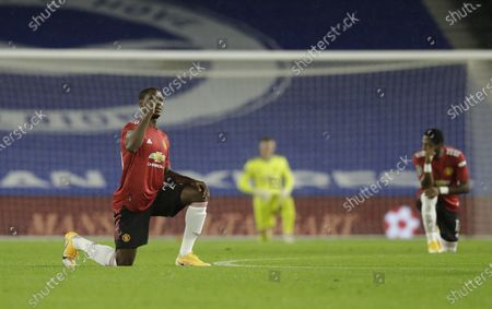 Odion Ighalo of Manchester United takes a knee to support the Black Lives Matter movement prior to the English Carabao Cup 4th round soccer match between Brighton Hove Albion and Manchester United in Brighton, Britain, 30 September 2020.