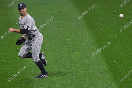 New York Yankees' Brett Gardner runs for an RBI double by Cleveland Indians' Jose Ramirez during the first inning of Game 2 of an American League wild-card baseball series, in Cleveland