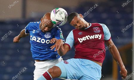 Fabian Delph (L) of Everton in action against  Sebastien Haller of West Ham (R) during the English Carabao Cup 4th round match between Everton and West Ham United in Liverpool, Britain, 30 September 2020.