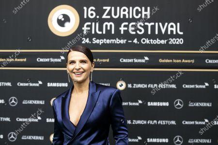 Stock Photo of Juliette Binoche poses on the Green Carpet during the 16th Zurich Film Festival (ZFF) in Zurich, Switzerland, 30 September 2020.