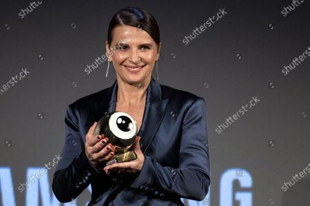 Stock Picture of Juliette Binoche receives the golden icon award during the 16th Zurich Film Festival (ZFF) in Zurich, Switzerland, 30 September 2020.