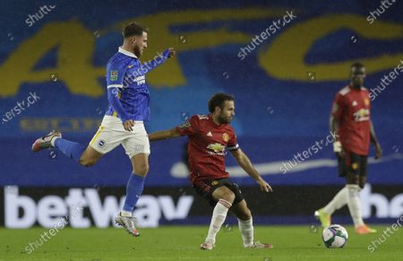 Jose Izquierdo (L) of Brighton in action against  Juan Mata (C) of Manchester United during the English Carabao Cup 4th round soccer match between Brighton Hove Albion and Manchester United in Brighton, Britain, 30 September 2020.