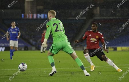 Stock Photo of Brighton goalkeeper Jason Steele (C) in action against Odion Ighalo (R) of Manchester United during the English Carabao Cup 4th round soccer match between Brighton Hove Albion and Manchester United in Brighton, Britain, 30 September 2020.