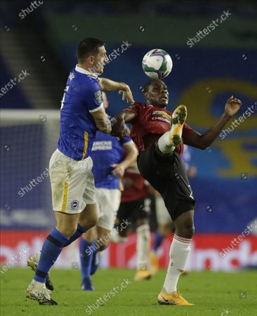 Lewis Dunk (L) of Brighton in action against Odion Ighalo (R) of Manchester United during the English Carabao Cup 4th round soccer match between Brighton Hove Albion and Manchester United in Brighton, Britain, 30 September 2020.