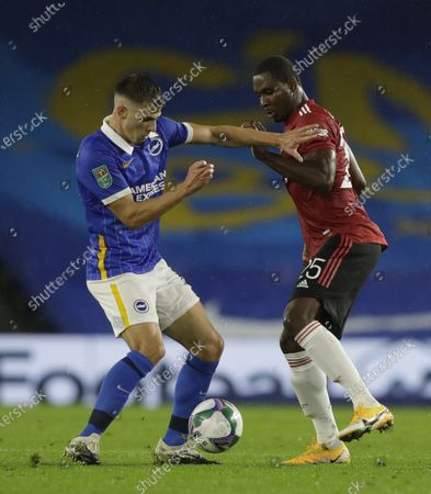 Jayson Molumby (L) of Brighton in action against Odion Ighalo (R) of Manchester United during the English Carabao Cup 4th round soccer match between Brighton Hove Albion and Manchester United in Brighton, Britain, 30 September 2020.
