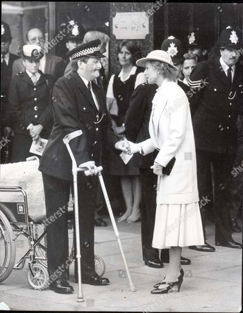 Princess Alexandra & Angus Ogilvy 1985-1992 - 24 September 1985 Princess Alexandra Unveiled A Memorial To The Police Officers Killed In The Harrods Bomb Blast And Then With A Gentle Touch Of The Hand Comforted A Constable Who Laid A Wreath For His Colleagues. Pc Jon Gordon Lost His Legs In The Explosion Which Also Killed His Dog Queenie But Was Able To Pull Himself From His Wheelchair And Limp Over To The Blue Pearl Granite Stone Close To The Knightsbridge Store. Someone Else Had To Carry The Flowers For Him. Security Was Strict With Some Streets Sealed Off And Police Marksmen On Rooftops As The Princess Drew Aside Velvet Curtains To Reveal The Memorial Which Reads: 'here Fell Insp Stephen Dodd Ps Noel Lane Wpc Jane Arbuthernot 17th December 1983....royalty .......the Right Hon Sir Angus Ogilvy (died 26/12/04) Pkt 1113 - 34324