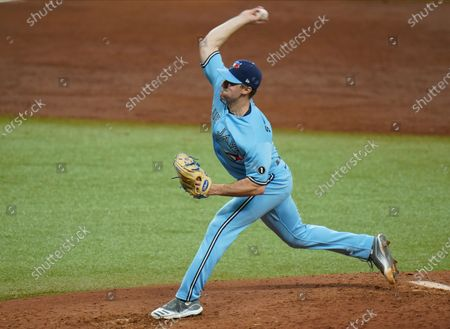 Stock Photo of Toronto Blue Jays starting pitcher Ross Stripling during the second inning of Game 2 of an American League wild-card baseball series against the Tampa Bay Rays, in St. Petersburg, Fla
