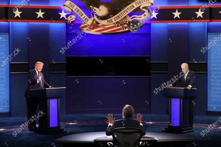 Stock Image of Moderator Chris Wallace (C) attempts to stop US President Donald J. Trump (L) from interrupting Democratic presidential candidate Joe Biden (R) during the first 2020 presidential election debate at Samson Pavilion in Cleveland, Ohio, USA, 29 September 2020 (issued 30 September 2020). On 30 September the Commission on Presidential Debates announced it is considering format changes, stating 'last night's debate made clear that additional structure should be added to the format of the remaining debates to ensure a more orderly discussion.'
