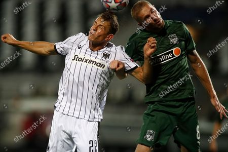 Paoks Stefan Schwab (L) in action against Krasnodars Yuri Gazinskiy (R) during the UEFA Champions League playoff 2nd leg soccer match between PAOK FC and FK Kransodar at Toumpa stadium in Thessaloniki, Greece, 30 September 2020.