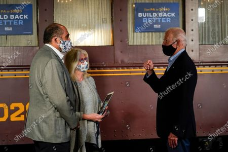 Franco Harris, former player for the Pittsburgh Steelers football player and his wife Dana Dokmanovich greet Democratic presidential candidate former Vice President Joe Biden before boarding his train at Amtrak's Latrobe Train Station, in Latrobe, Pa. Biden is on a train tour through Ohio and Pennsylvania today