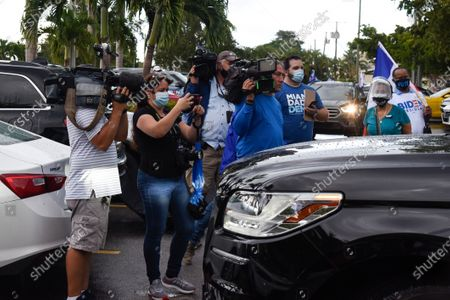 Press at the event not social distancing. Actress Eva Longoria and CNN host Ana Navarro, joined a caravan of cars to show their support of Biden and Harris in the 2020 Presidential election. The caravan of people drove around with banners and flags on their cars, in the Miami neighborhood of Little Havana also known' as Calle Ocho.
