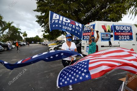 Stock Image of Actress Eva Longoria and CNN host Ana Navarro, joined a caravan of cars to show their support of Biden and Harris in the 2020 Presidential election. The caravan of people drove around with banners and flags on their cars, in the Miami neighborhood of Little Havana also known' as Calle Ocho.