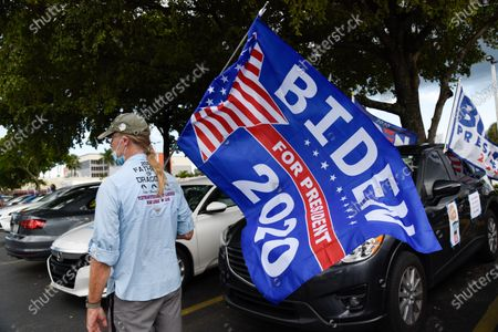 Actress Eva Longoria and CNN host Ana Navarro, joined a caravan of cars to show their support of Biden and Harris in the 2020 Presidential election. The caravan of people drove around with banners and flags on their cars, in the Miami neighborhood of Little Havana also known' as Calle Ocho.