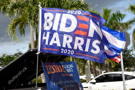 Stock Picture of Actress Eva Longoria and CNN host Ana Navarro, joined a caravan of cars to show their support of Biden and Harris in the 2020 Presidential election. The caravan of people drove around with banners and flags on their cars, in the Miami neighborhood of Little Havana also known' as Calle Ocho.