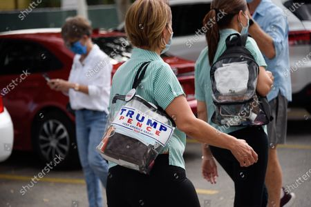 Waitstaff is seen leaving Versailles Restaurant, one is a Trump supporter. Actress Eva Longoria and CNN host Ana Navarro, joined a caravan of cars to show their support of Biden and Harris in the 2020 Presidential election. The caravan of people drove around with banners and flags on their cars, in the Miami neighborhood of Little Havana also known' as Calle Ocho.
