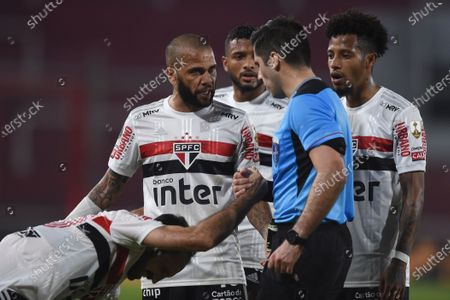 Daniel Alves of Brazil's Sao Paulo complains to referee Cristian Garay during a Copa Libertadores Group D soccer match against Argentina's River Plate in Buenos Aires, Argentina