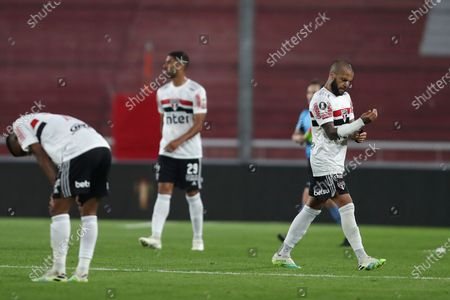 Daniel Alves of Brazil's Sao Paulo, right, leaves the field after his side's 1-2 lost against Argentina's River Plate during a Copa Libertadores Group D soccer match in Buenos Aires, Argentina