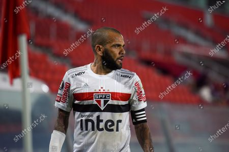 Daniel Alves of Brazil's Sao Paulo leaves the field after his side's 1-2 lost against Argentina's River Plate in a Copa Libertadores Group D soccer match in Buenos Aires, Argentina