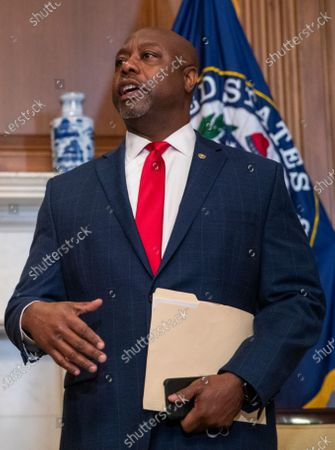 United States Senator Tim Scott (Republican of South Carolina) responds to a question from the news media during his meeting with US Supreme Court nominee Judge Amy Coney Barrett (L) in the US Capitol in Washington, DC, USA, 30. Senator Scott was asked about President Trump's remarks about white supremacy in the first presidential debate.