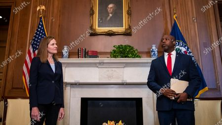 United States Supreme Court nominee Judge Amy Coney Barrett (L) meets with US Senator Tim Scott (Republican of South Carolina) in the US Capitol in Washington, DC, USA, 30. Supreme Court Nominee Judge Amy Coney Barrett will meet individually with Senators this week prior to her confirmation hearings that are scheduled to start 12 October.