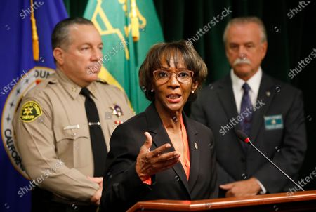 District Attorney Jackie Lacey, Los Angeles County Sheriff Alex Villanueva, left, and Homicide Bureau Captain Kent A. Wegener, right, announce an arrest of Deonte Lee Murray in the ambush shooting of two on-duty deputies who were sitting in their marked patrol car at the Metro Blue Line station in Compton September 12, 2020. Hall Of Justice on Wednesday, Sept. 30, 2020 in Los Angeles, CA. (Al Seib / Los Angeles Times