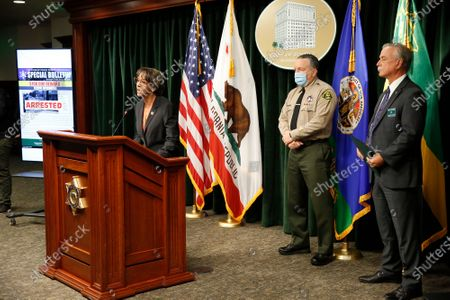 District Attorney Jackie Lacey, Los Angeles County Sheriff Alex Villanueva, and Homicide Bureau Captain Kent A. Wegener, right, announce an arrest of Deonte Lee Murray in the ambush shooting of two on-duty deputies who were sitting in their marked patrol car at the Metro Blue Line station in Compton September 12, 2020. Hall Of Justice on Wednesday, Sept. 30, 2020 in Los Angeles, CA. (Al Seib / Los Angeles Times
