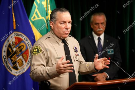 Los Angeles County Sheriff Alex Villanueva and Homicide Bureau Captain Kent A. Wegener, right, announce an arrest of Deonte Lee Murray in the ambush shooting of two on-duty deputies who were sitting in their marked patrol car at the Metro Blue Line station in Compton September 12, 2020. Hall Of Justice on Wednesday, Sept. 30, 2020 in Los Angeles, CA. (Al Seib / Los Angeles Times