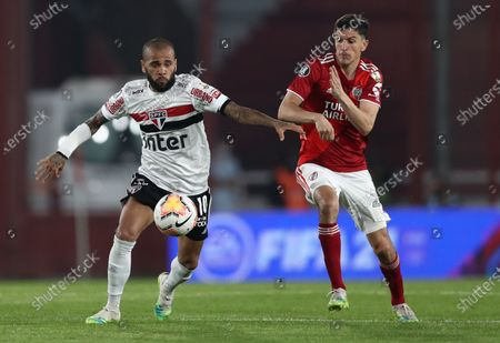Milton Casco (R) of River vies for the ball with Daniel Alves (L) of Sao Paulo during their Copa Libertadores group D soccer match between River Plate and Sao Paulo FC at Libertadores de America stadium in Avelleneda, Argentina, 30 September 2020.