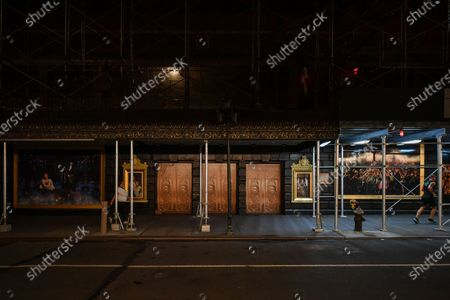 Scaffolding covers the exterior of The Majestic Theatre at 247 West 44th Street New York, NY, which remains closed and dark. Andrew Lloyd Webber's 'The Phantom of the Opera,' Broadway's longest running musical, posters still adorn the theater.