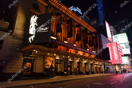 Lunt-Fontanne Theatre at 205 W 46th St New York, NY remains lit up, but closed. Posters for 'Tina,' the Tina Turner Musical still adorn the theater.