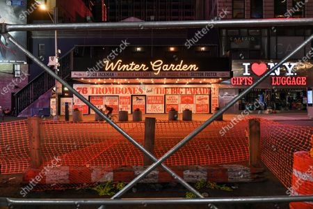 Winter Garden Theatre at 1634 Broadway, New York, NY remains lit, but closed. Posters of 'Music Man,' starring Hugh Jackman, still adorn the theater.