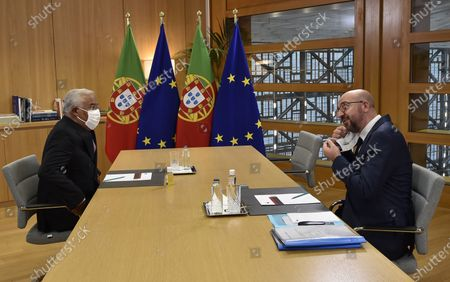 Stock Image of European Council President Charles Michel (R) adjusts his facemask as he speaks with Portugal's Prime Minister Antonio Costa ahead of a bi-lateral meeting on the first day of a European Union (EU) summit at The European Council Building in Brussels, Belgium, 01 October 2020.